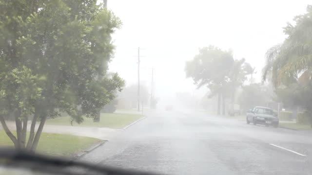 Car stopped on roadside stuck in rain windscreen wipers on video