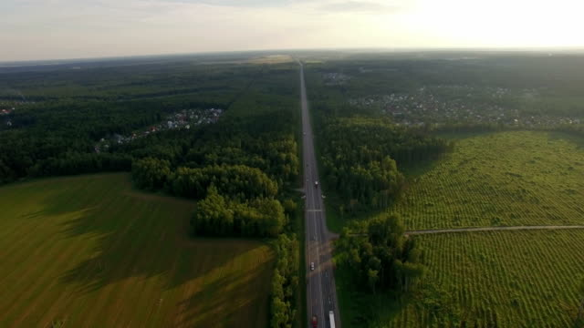 Car traffic on the countryside road in Russia, aerial video