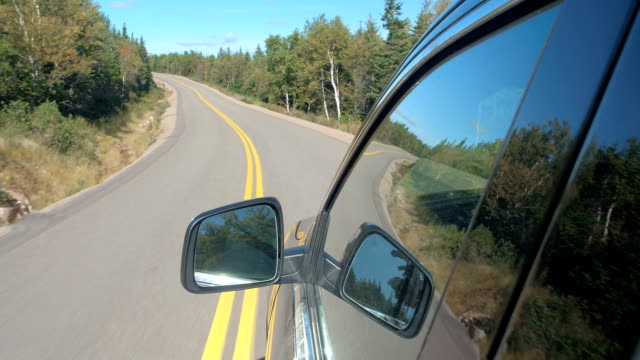 FPV: SUV car traveling along the empty highway through Canadian backcountry video