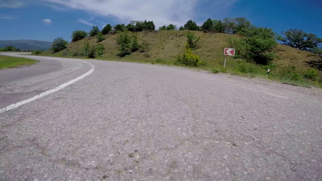 Car POV trip along winding road among the hills on southern coast of Crimea video