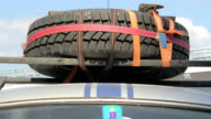 Car tyre on top of vehicle timelapse, retro vintage transport video