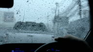 Car windshield in traffic jam during rain video