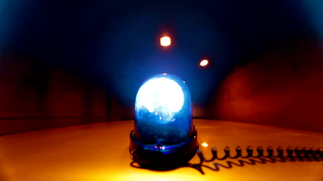 Car With Blue Emergency Light Driving Through A Tunnel video