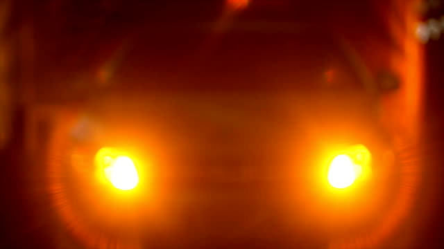 Car with flashing hazard lights at night video