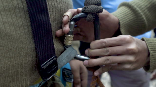 Carabiner being attached to harness video