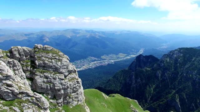 Caraiman Mountains, aerial flight reveiling Bucegi city, Romania video