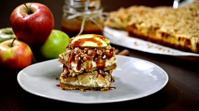 Caramel Apple Cheesecake Bars.Apple cheesecake with caramel apples sauce video
