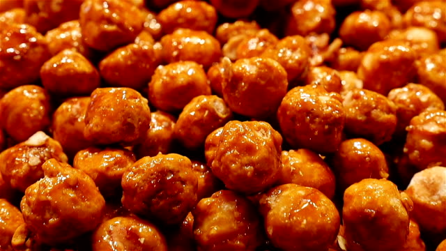 Caramelized hazelnuts at the La Boqueria food market, Barcelona, Spain video