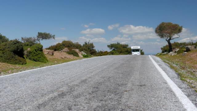 Caravanü camper van on majestic empty road, Assos, Turkey video