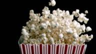 Cardboard box in super slow motion spilling popcorn video