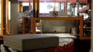Cardboard brown package rolling on conveyor belt video