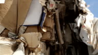 Cardboard stacked for recycling on a windy day video
