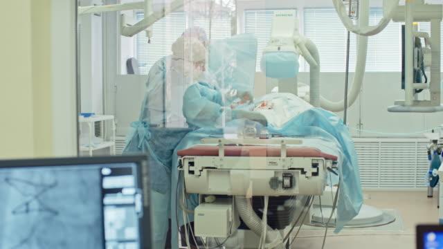 Cardiovascular Surgery Behind Glass Wall video