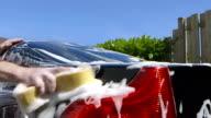 Care Care - Man washing a car using a sponge video