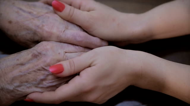 Care of the elderly,human hands close up,b roll video
