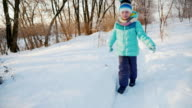 Carefree child trips out on snow-covered path video