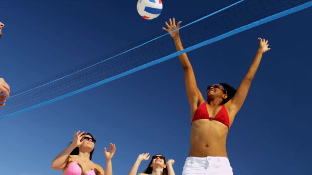 Carefree Young People Vacation Beach Volleyball video