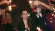 Carefree Youth Dancing with Sparklers in Night Club video