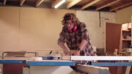 Carefully shaping wood for his new design video