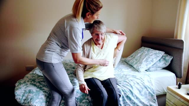 Caregiver Helping Senior Woman Dress video
