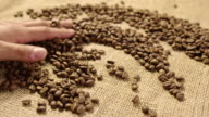 Caressing coffe beans 4K slow motion video