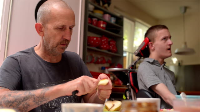 Caretaker father with disabled son video