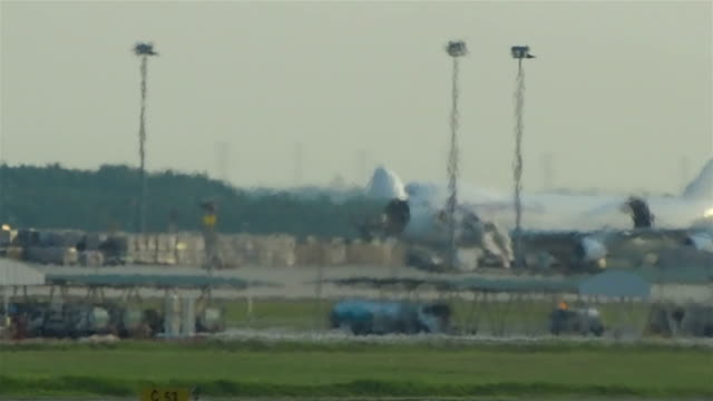 Cargo aircraft behind hot jetstream in the airport video