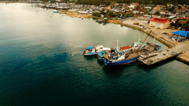 Cargo and passenger transit port in Dapa city aerial view .Siargao island, Philippines video