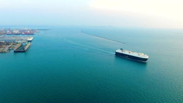 cargo container ship sailing over blue sea video