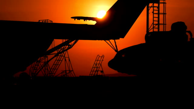 Cargo helicopters at sunset video