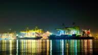 Cargo sea port with cranes. Night scene timelapse video
