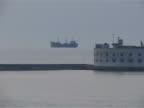 cargo ship anchored in the open sea video
