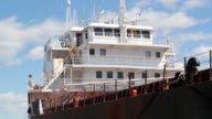 Cargo ship at dock. Closeup. Timelapse. video