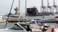 Cargo ship docking in the harbor video