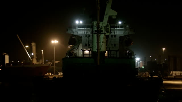 Cargo Ship in Port at Night video