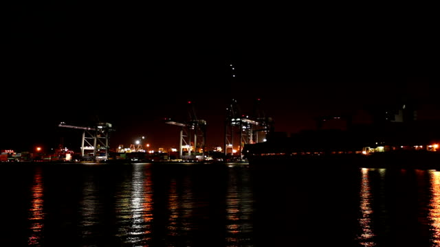 Cargo ship in the harbor at night. video