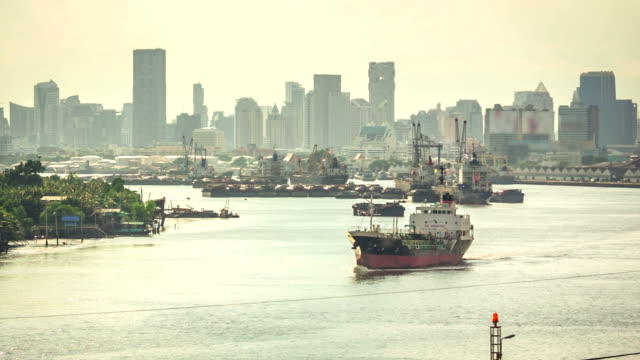 Cargo ship on the River in a big city video