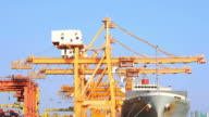 Cargo ship unloading goods at shipping port video