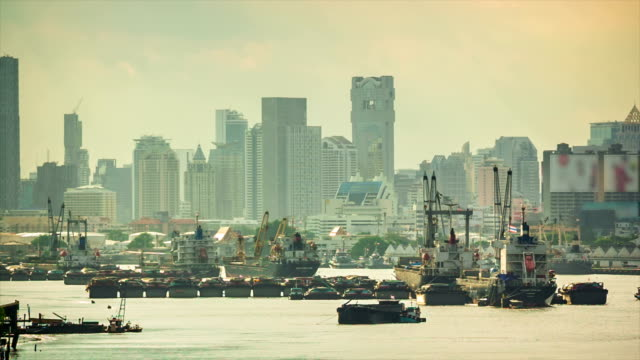 Cargo ship waiting on the River in a big city video