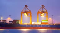 Cargo Ship Working in Terminal at dusk with raining video