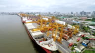 Cargo ships loading with containers video