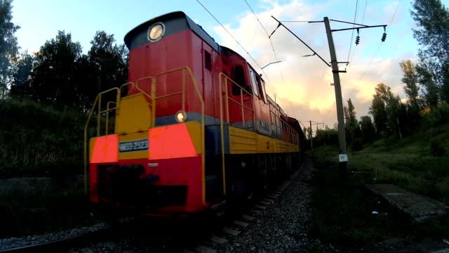 Cargo train passing on railroad tracks video