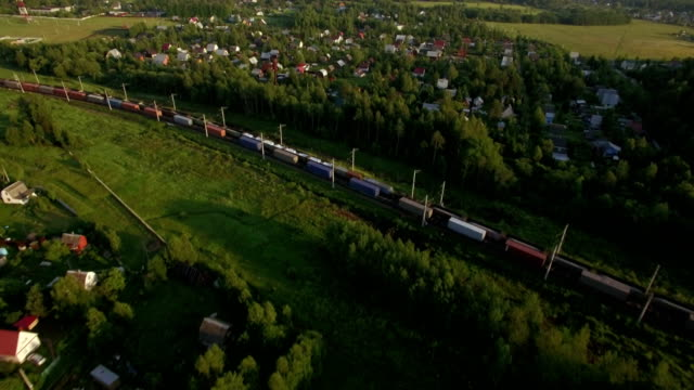 Cargo trains traveling in the countryside, Russia video
