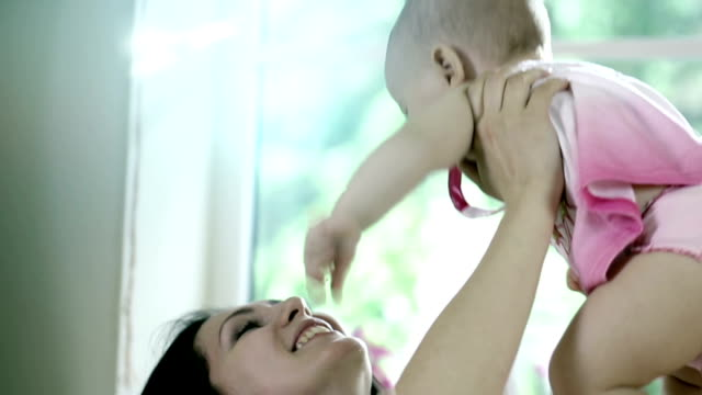 Caring mother with baby, Concept of love and family. closeup, Mother care. Playing with baby at home.. Slow Motion. video