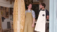Carpenter And Apprentice With Surfboard Shot On RED Camera video