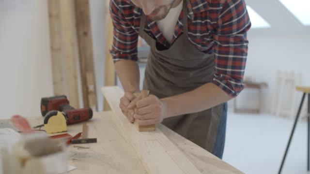 4K: Carpenter Carving Plank. video