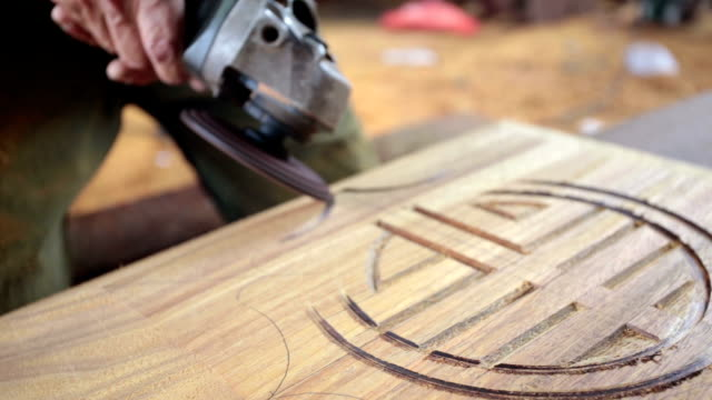 carpenter crafting traditional chinese coffin.Real time. video