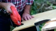Carpenter cutting a panel with a jigsaw video