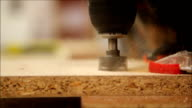 carpenter drill holes with a drill, making furniture video