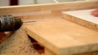carpenter drill holes with a drill video